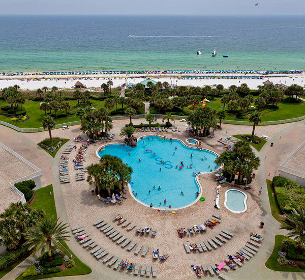 Aerial view of the Gulf-front pool and beach at Silver Shells Destin FL