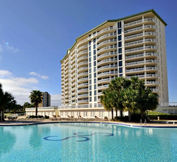 Side view of the exterior and pool at Silver Shells Destin FL
