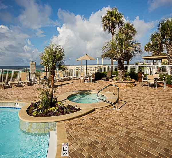 Seasonally heated pool at Sterling Sands Condominiums in Destin Florida