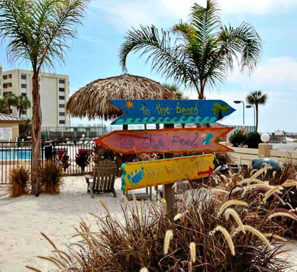 Colorful signs directing guests to the beach pool and Key West at The Islander Destin