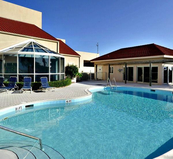 Outdoor pool and children's pool at TOPS'L Beach Manor   in Destin Florida