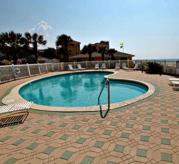 Enjoy relaxing around the pool at Windancer Condominiums in Destin Florida