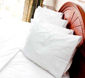 A bedroom at Embassy Suites Hotel Destin at Miramar Beach in Destin Florida