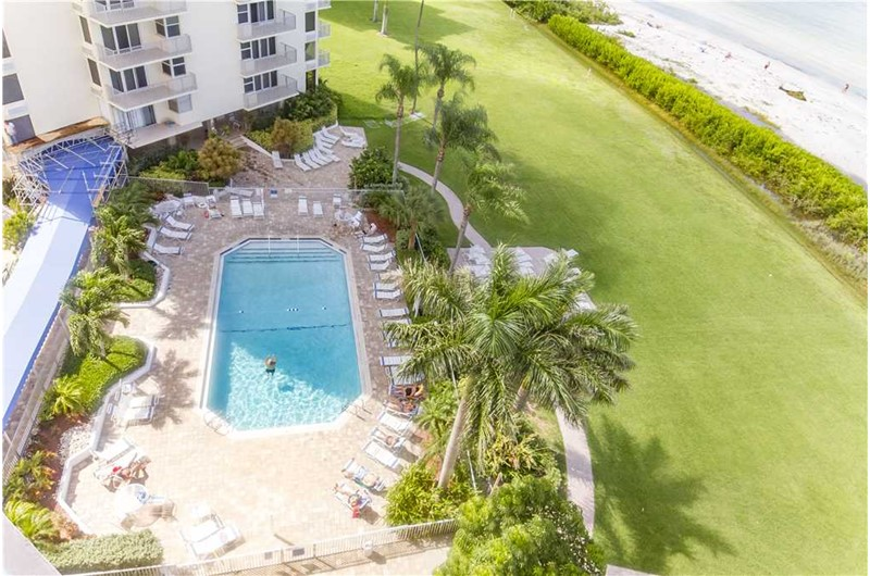View the pool from balcony at Estero Beach and Tennis Club in Fort Myers Beach FL