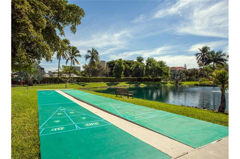 Play shuffleboard while staying at Estero Beach and Tennis Club in Fort Myers Beach FL