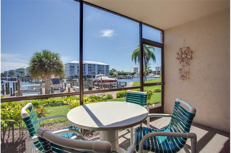 Enjoy view of boats and canal from Estero Yacht & Racquet in Fort Myers Beach Florida