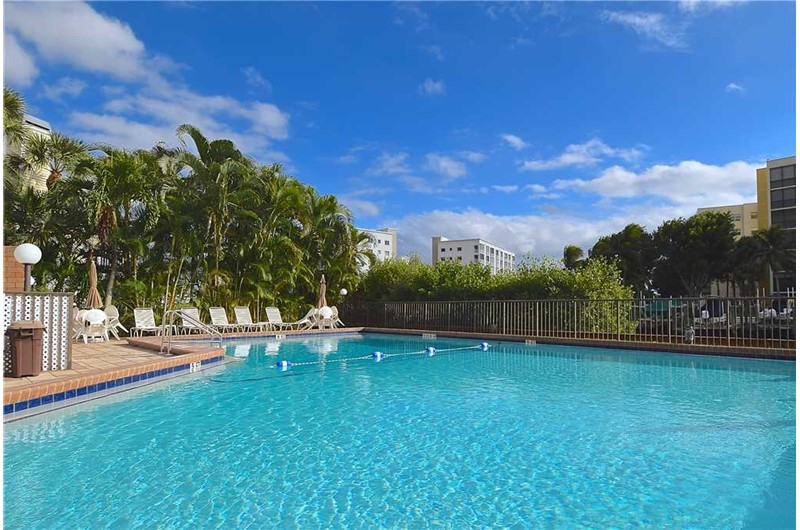 Enjoy the large heated pool at Estero Yacht & Racquet in Fort Myers Beach Florida