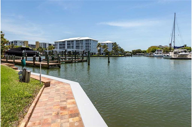 Relax as you walk along the harbor at Palm Harbor Condos in Fort Myers Beach FL