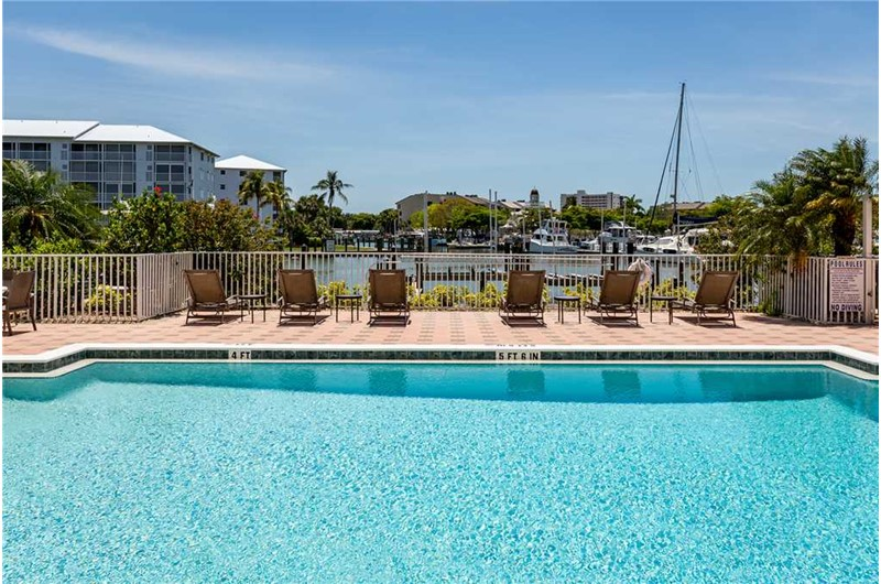 Swim in the pool that is directly on the harbor at Palm Harbor in Fort Myers Beach FL