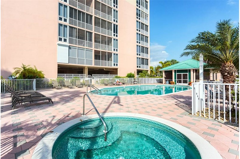 Relax by the pool and enjoy the hot tub at Palm Harbor in Fort Myers Beach FL