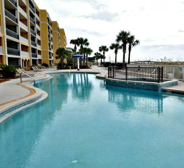 Gulf-front swimming pool and mushroom fountain at Azure Fort Walton Beach