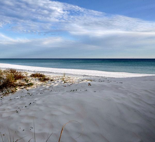 White sand beach just steps from Island Echos Condominiums in Fort Walton Florida