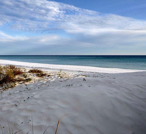 White sand beach just steps from Island Echos Condominiums in Fort Walton Florida