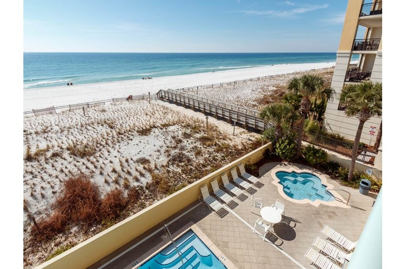 Have a birds eye view of the pool hot tub and beach at Pelican Isle Condos in Fort Walton Florida