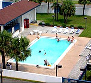 View from above of the pool and sundeck at Surf Dweller Fort Walton Beach