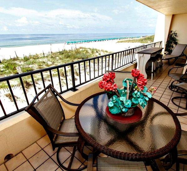 Beachfront balcony with table and chairs at Surf Dweller  Fort Walton Beach