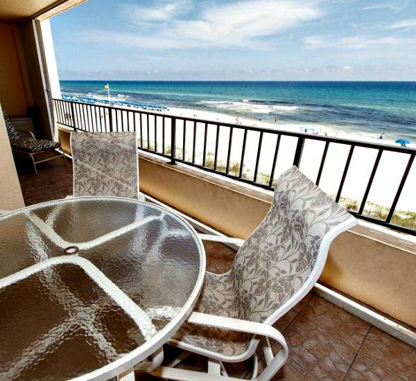 Table and chairs on a Gulf-front balcony at Surf Dweller Fort Walton Beach