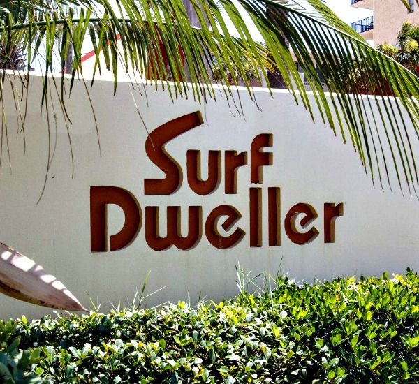 Palm-shaded sign outside Surf Dweller Fort Walton Beach