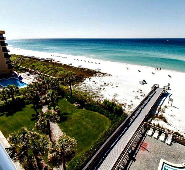 Aerial view of the grounds boardwalk and beach at Waters Edge Condos in Fort Walton FL