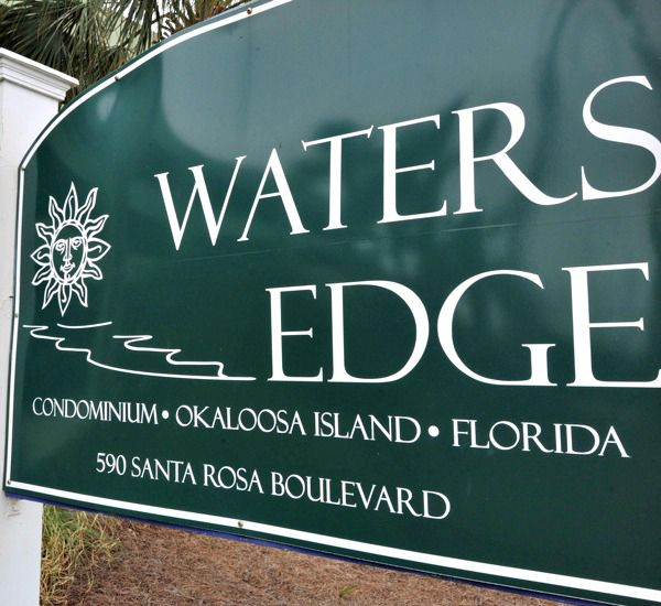 Street-side sign at Waters Edge Condos in Fort Walton Florida