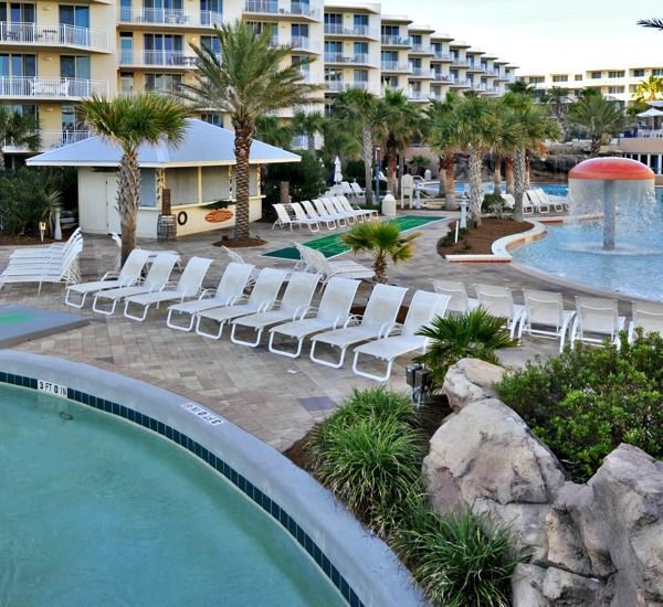 Poolside sundeck and mushroom fountain at Waterscape Resort in Fort Walton Beach