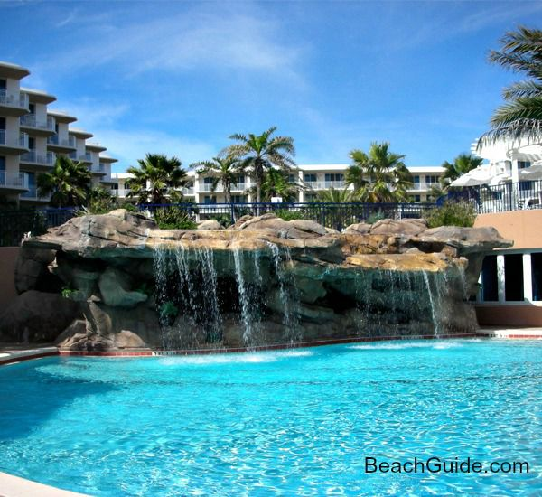 Swimming pool with waterfall at Waterscape Resort in Fort Walton Beach