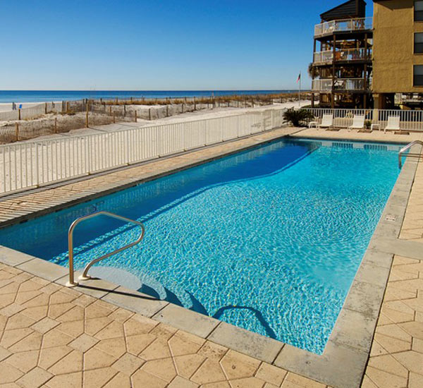 Beachfront pool at Caribbean Condominiums in Gulf Shores AL