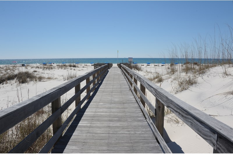 A boardwalk offers easy access to the beach at Gulf Shores Plantation.