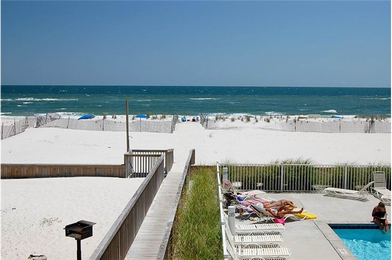 View of the pool and beach at Gulf Village Gulf Shores AL