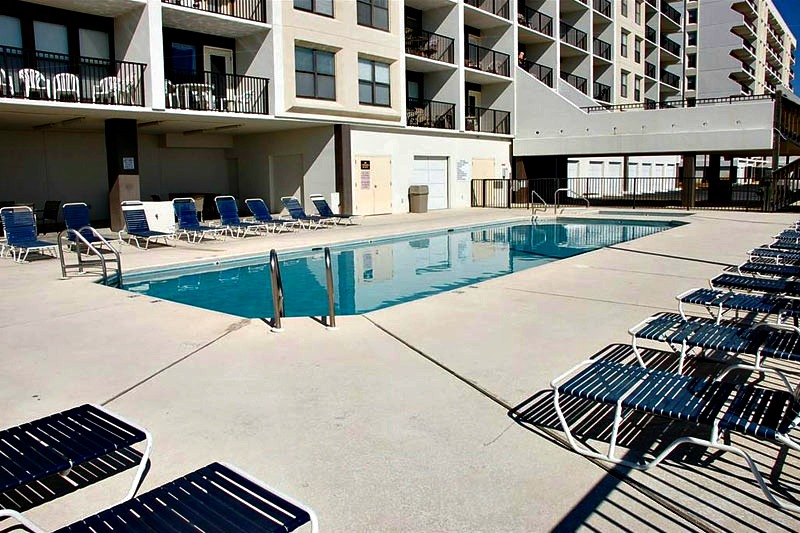 Swimming pool and sundeck at Island Sunrise Gulf Shores