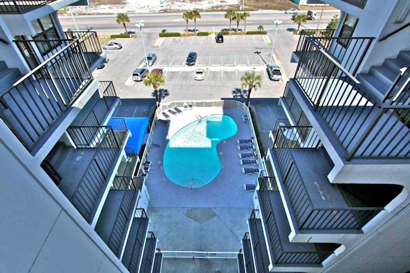 Aerial view of the pool and private balconies at Island Sunrise Gulf Shores