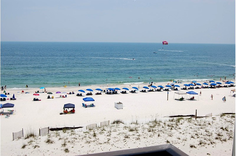 Walk directly onto the sugar white sand from Island Sunrise in Gulf Shores AL