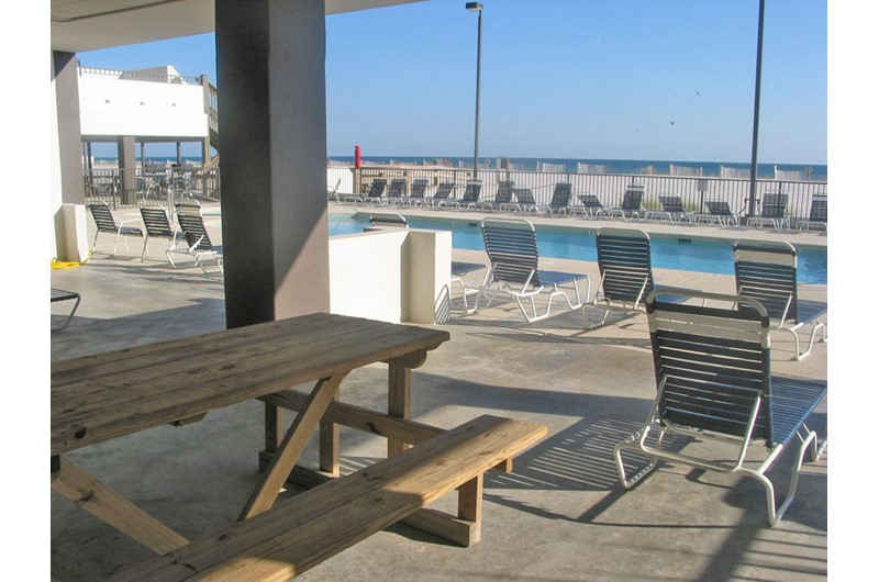 Shady pool deck for relaxing at Island Winds West in Gulf Shores AL