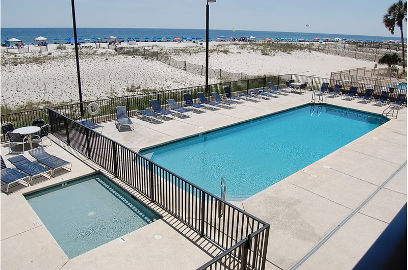 Stay relaxed at the pool and hot tub at Island Winds West in Gulf Shores AL