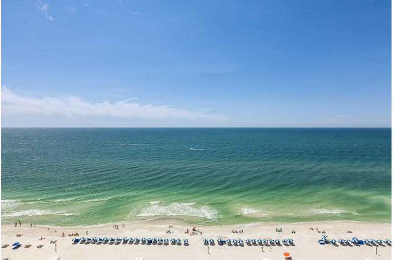 The gorgeous Gulf of Mexico stretches toward the horizon in this balcony view at the Lighthouse Gulf Shores.