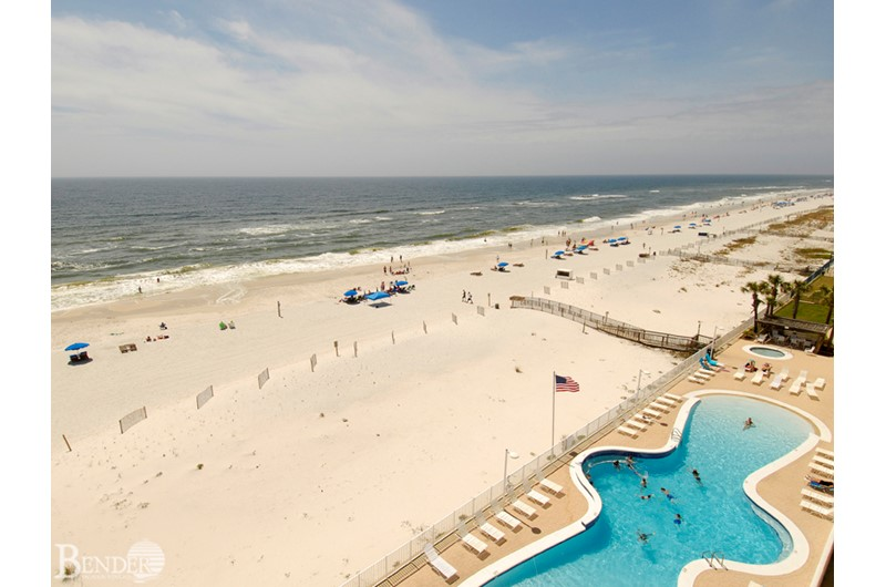 View of the pool and beach from above at Ocean House Gulf Shores