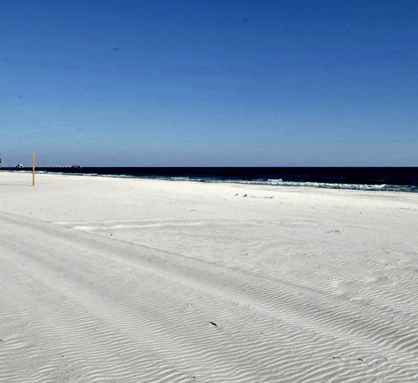 Expansive beach in front of San Carlos Gulf Shores