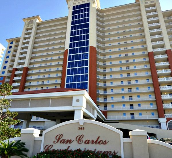 Exterior view from the street and sign at San Carlos Gulf Shores