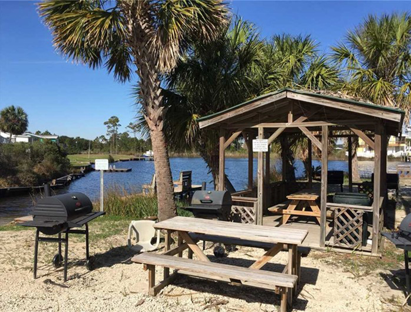 Grill your family dinner and enjoy a view of the water at The Cove in Gulf Shores Alabama