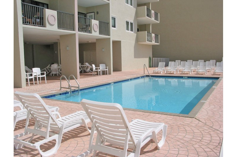 Relax poolside at Tropical Winds Gulf Shores AL.