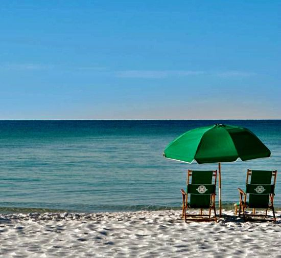 Beach chairs and umbrella on the beach at Hidden Dunes  in Destin Florida