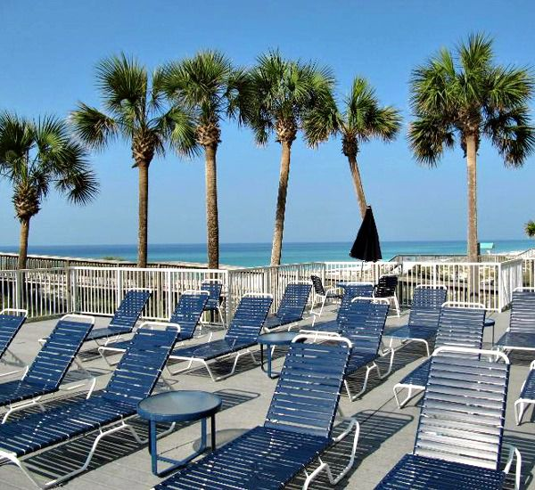 Chaise lounges on the beach at Hidden Dunes  in Destin Florida