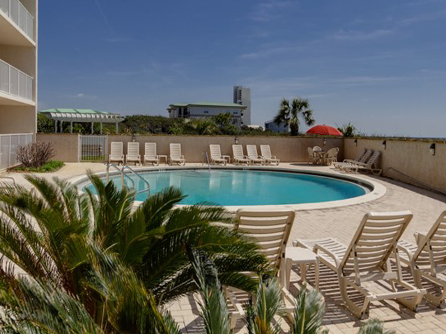 Lush landscape surrounds this large pool at Beachcrest Seagrove Beach Florida