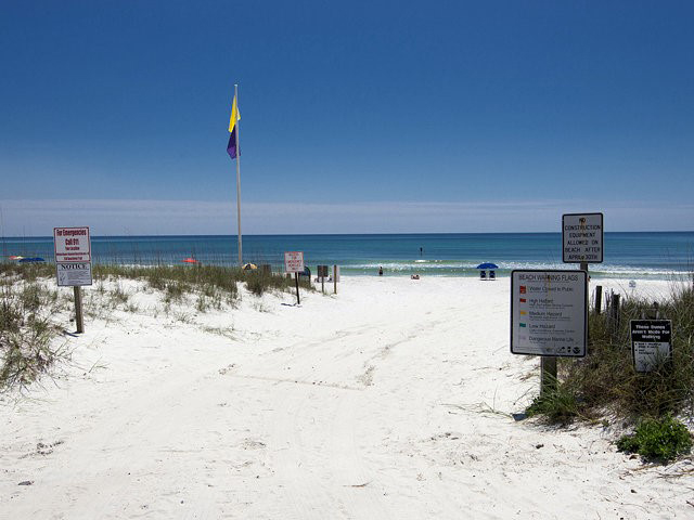 Soft white sand greats you steps from Beachfront II in Seagrove Beach Florida