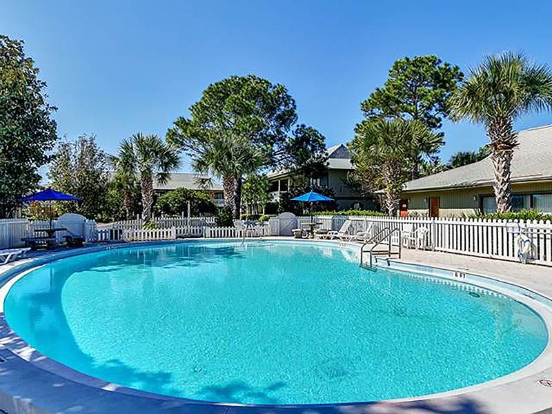 Lounge around the large pool at Beachwood Villas in Seagrove Beach FL