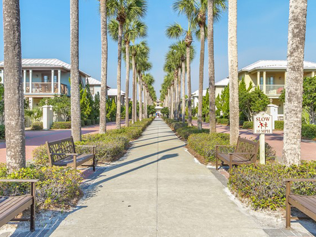 Stroll along the palm-lined walkway at Inn at Seacrest Beach Highway 30-A Florida