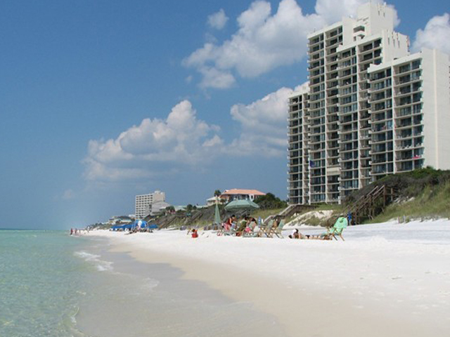 View of beach and water in front of One Seagrove Place Highway 30a Florida