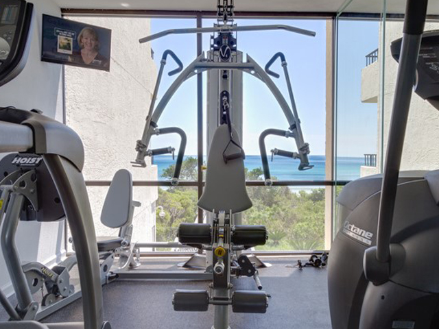 Get your exercise in the workout room at One Seagrove Place Highway 30a Florida