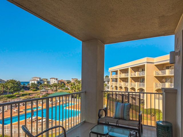 You can enjoy the lovely pool and landscaping from your balcony at San Remo Santa Rosa Beach Florida