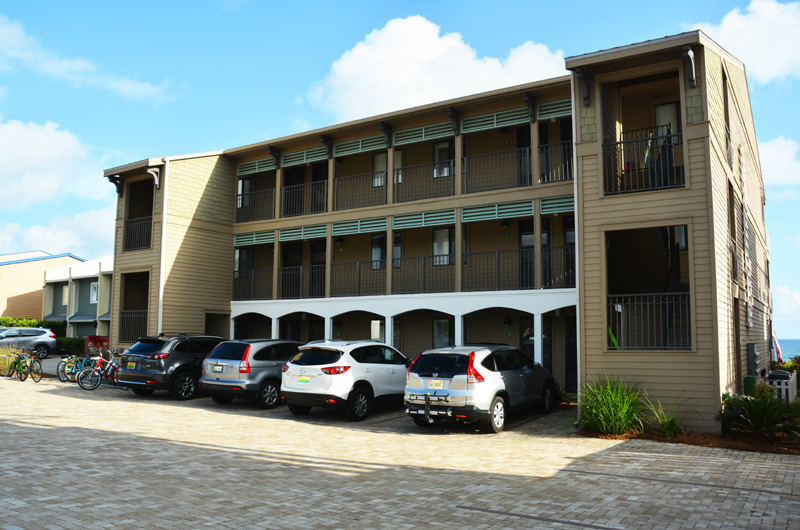 Front side view of Seamist Condominiums in Seacrest Beach FL. Showing a beautiful tan and beige brick parking lot. 30a rentals.